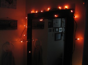 Orange lights on bathroom mirror